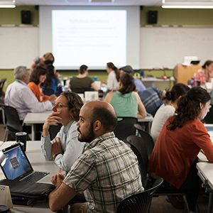 Participants at the 2017 Northwest Regional Summer Institute on Scientific Teaching at the University of Oregon discuss how to support improved student learning outcomes in the sciences and make other improvements to STEM education.  Photo courtesy of Dan Barton, Humboldt State University.