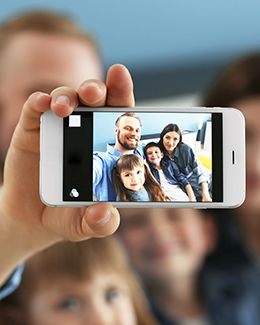 Family taking a selfie with the smartphone