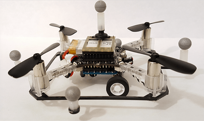 One of the researchers' quadcopter drones with wheels