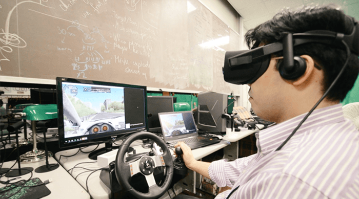 Researcher simulating self-driving car experience.