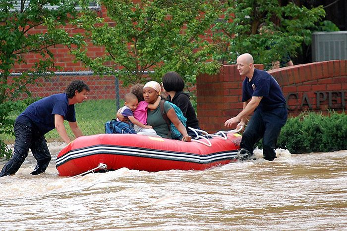 First responders rescuing resident from flooding
