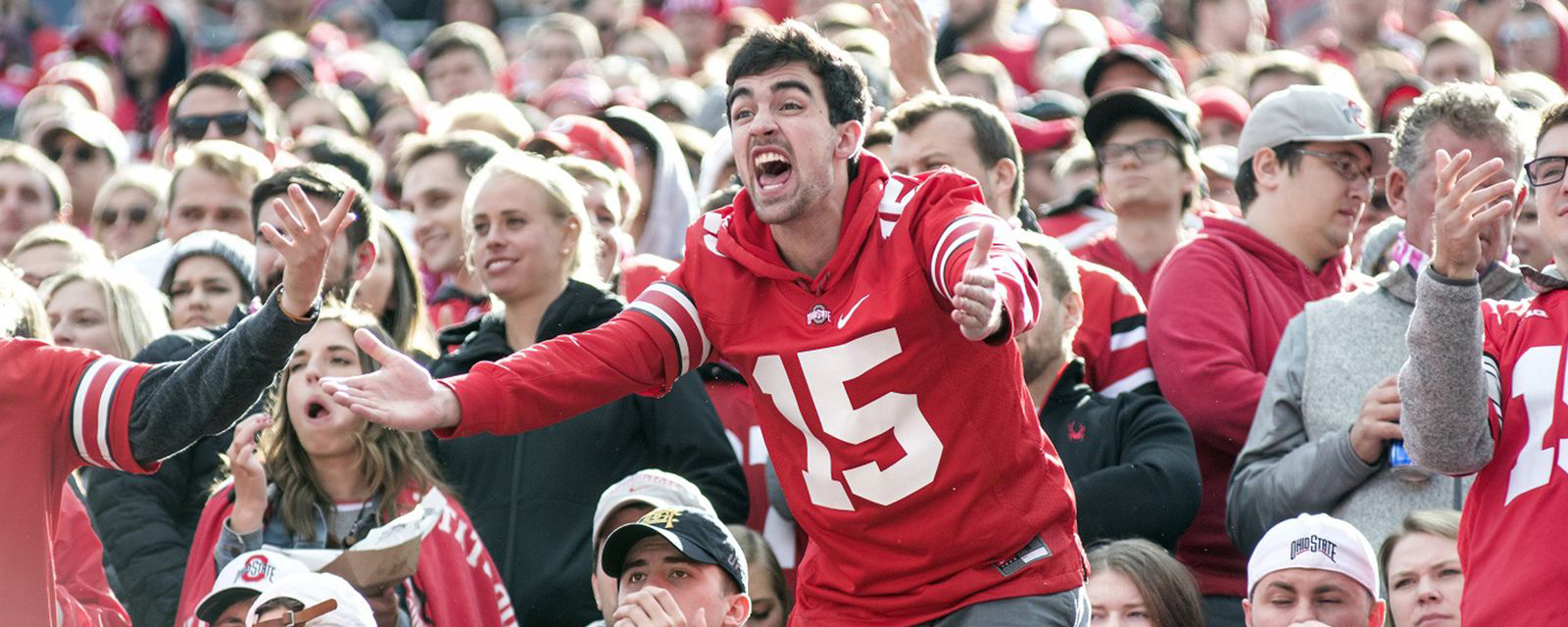 Ohio State fan cheering from the stands.