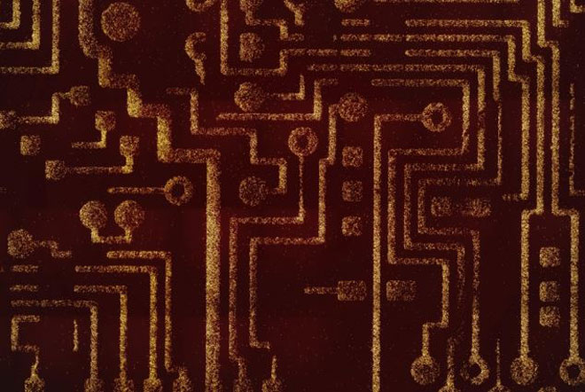 An image of a motherboard has been micropatterned using programmable probiotic bacteria.