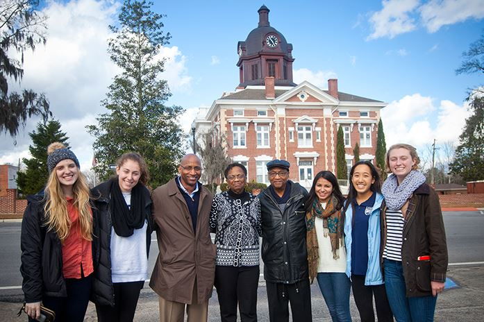 Emory University students Ellie Studdard and Emily Gaines; Tony Williams, son of Dorothy Williams; Dorothy Williams; her husband, Sam Williams; and students Sarah Husain, Emily Li and Lucy Baker.